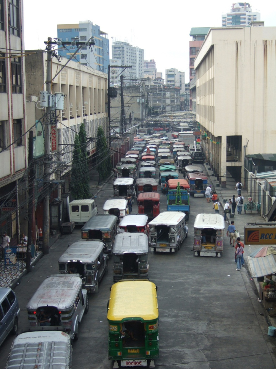 Fig. 16.1 The plethora of many small vehicles providing public transport services in cities such as Manila translates into significant system inefficiencies.